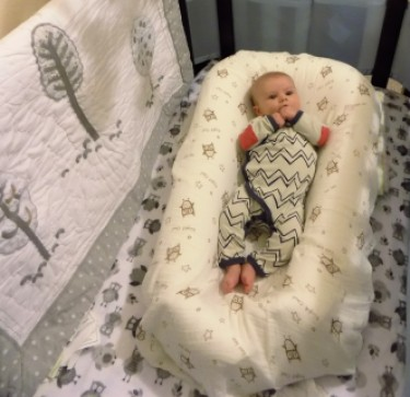 transitioning to the crib baby in dockatot - Baby Sleep Tips: Transitioning to the Crib by popular DC mommy blogger Baby Castan on Board