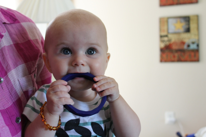 Aiden chewing on a teething toy