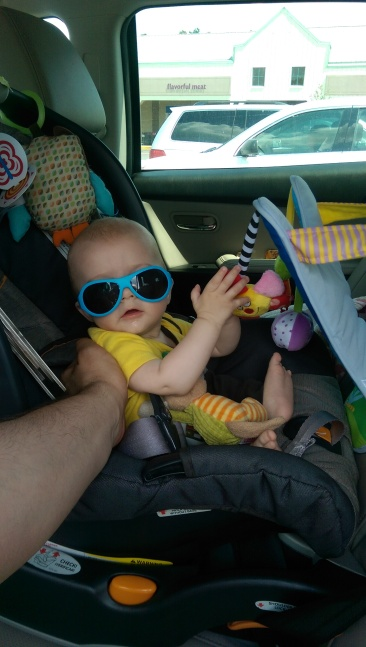 Aiden playing with toys in car