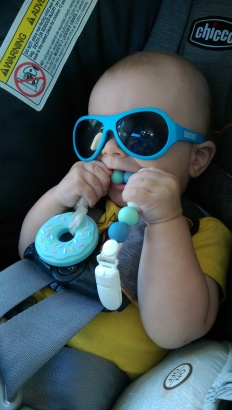 Aiden chewing on beads and donut teether