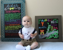 Aiden making a cute face with seven month chalkboards