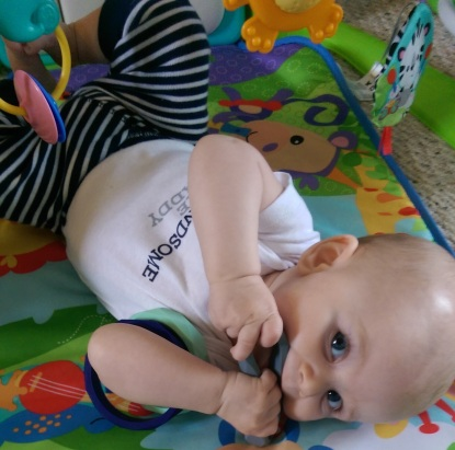 Aiden chewing on bangles