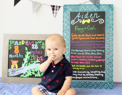 Aiden in front of 8 month board close up