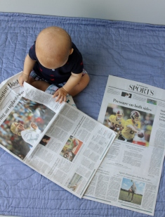 Aiden with newspapers