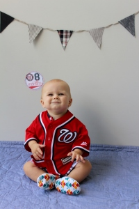 Aiden in Nationals jersey with eight month sticker